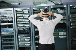 it business man in network server room have problems and looking for  disaster situation solution.