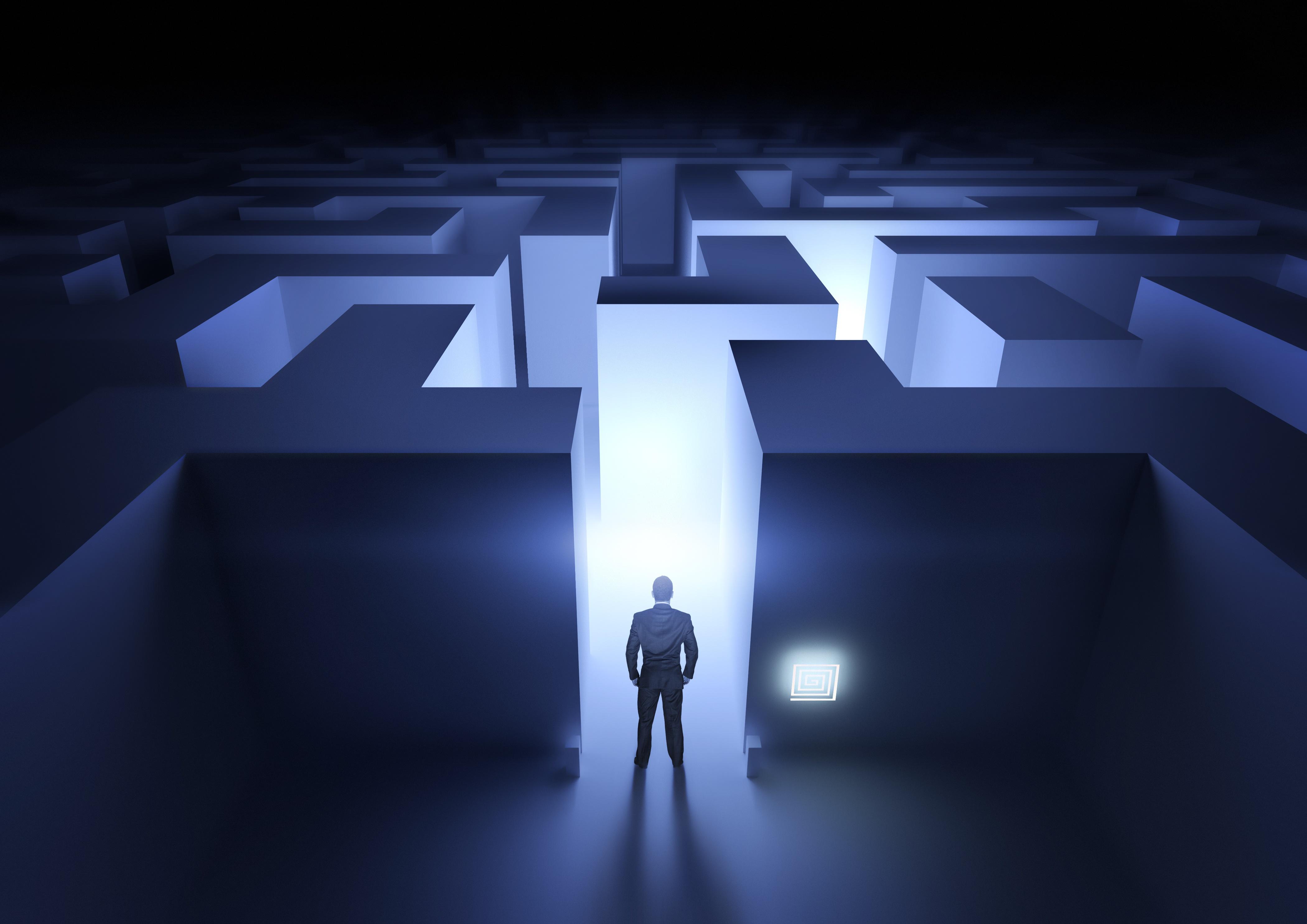 A man navigating his way through a technology maze.
